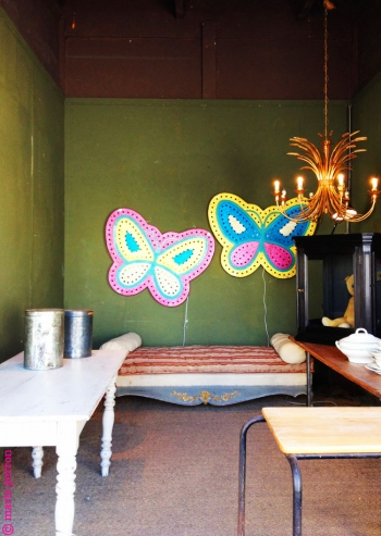 Link to Paris: Butterfly lamps on kaki walls
